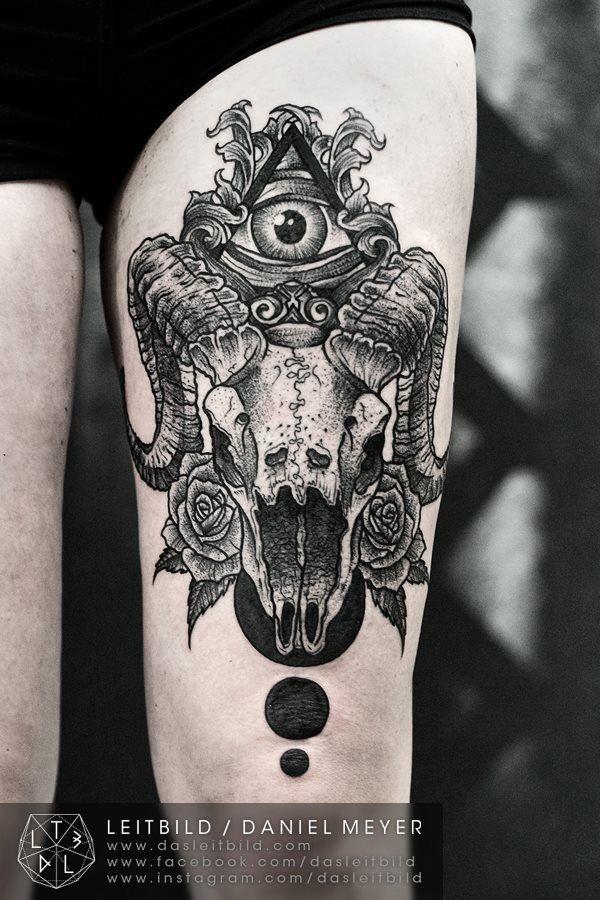 Terrifying black and white animal skull with Masonic pyramid tattoo on thigh