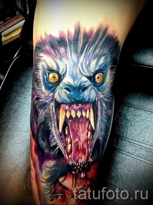 Terrifying colored arm tattoo of bloody wolf face
