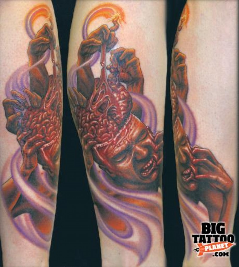 Terrifying colored bloody human with brain tattoo on leg