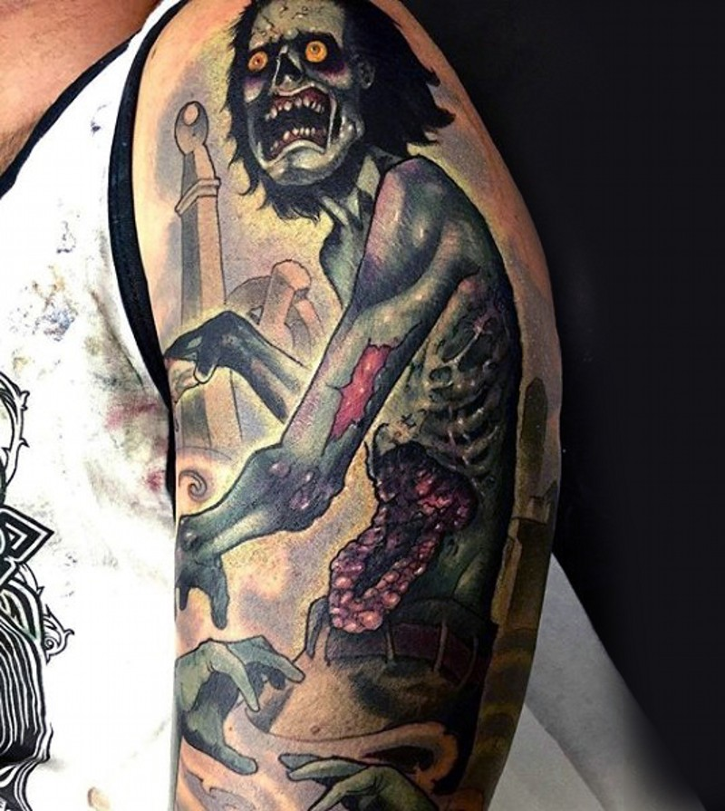 Terrifying colored detailed shoulder tattoo of zombie in cemetery