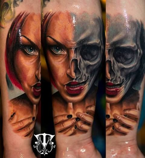 Terrifying colored horror style forearm tattoo of half woman half skull face