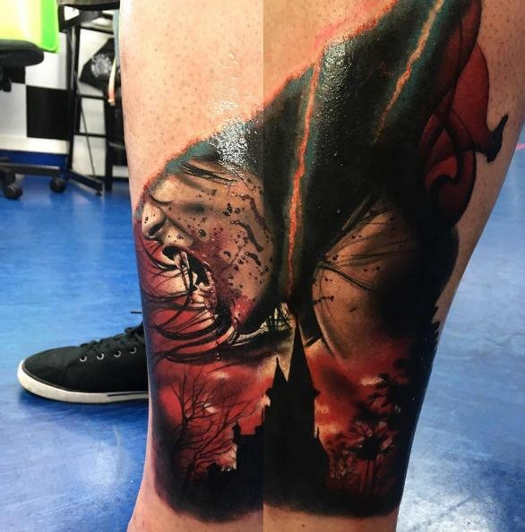 Terrifying colored leg tattoo of bloody woman vampire with dark city