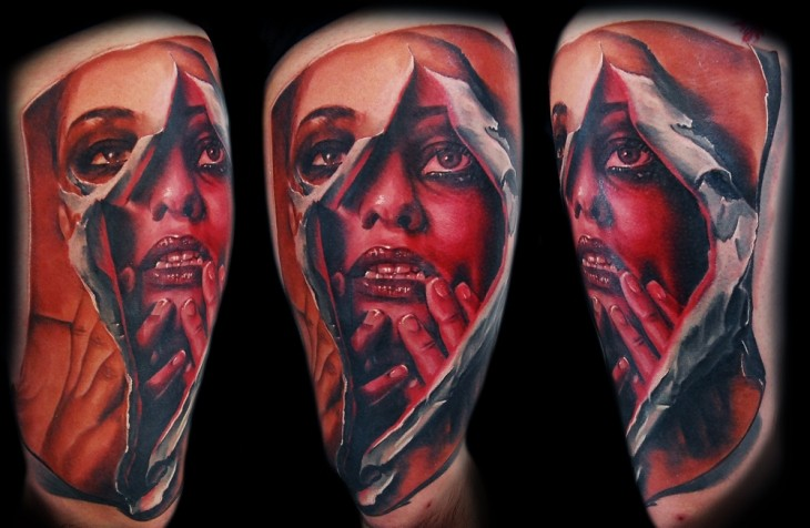 terrifying colored tattoo of ripped woman portrait