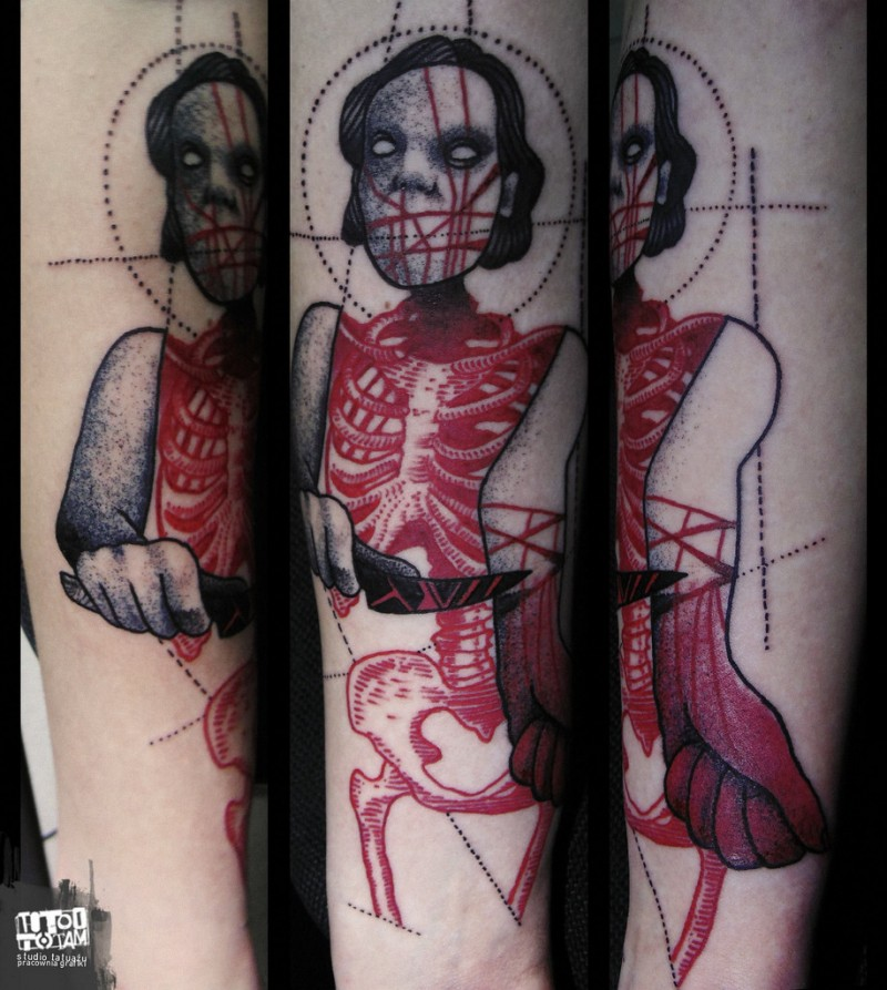 Terrifying surrealism style colored monster woman with knife tattoo on forearm