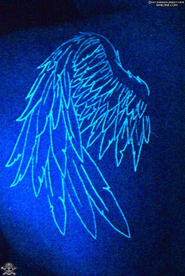 The wings on shoulder black light tattoo - Tattooimages.biz