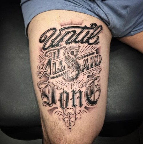 Thug style black and white various emblem letterings tattoo on thigh