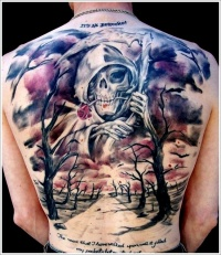 Coloured grim reaper with a scythe tattoo on back
