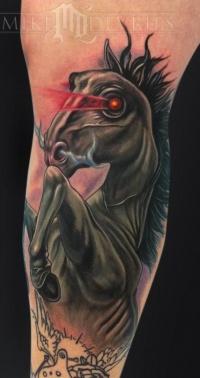 Dark horse head with glowing eyes tattoo