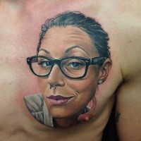 3D style colored chest tattoo of woman with piercing portrait