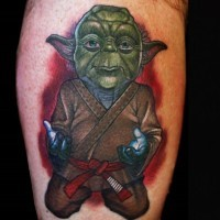 3D cartoon like painted and colored leg tattoo of Star Wars Yoda