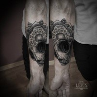 3D dot style forearm tattoo of mysterious cat skull with ornaments