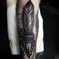 3D like antic arrow head tattoo on forearm combined with lettering