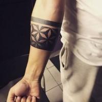 3D like black ink forearm tattoo of geometrical ornament