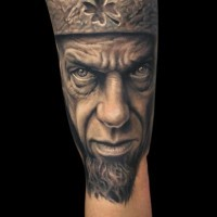 3D like detailed natural looking king portrait tattoo with crown