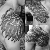 3D like eagle wing shaped chained detailed black ink tattoo on shoulder