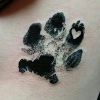 3D like little black ink animal print stylized with heart tattoo on side