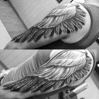3D like massive black ink feather wing tattoo on shoulder