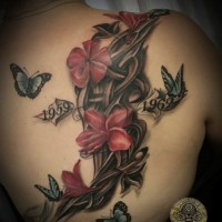 3D like massive memorial floral tattoo with dates and butterflies on shoulder