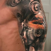 3d realistic statue of pharaoh tattoo on shoulder