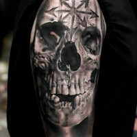3d spooky realistic skull with sacred sign tattoo on shoulder