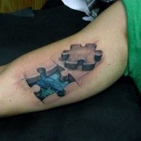 3D style amazing looking biceps tattoo of puzzle pieces and dragon skin