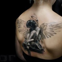 3D style breathtaking looking back tattoo of sad female angel