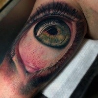 3D style colored biceps tattoo of human eye