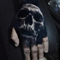 3D style colored by Eliot Kohek hand tattoo of human skull