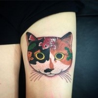 3D style colored cat head tattoo on thigh