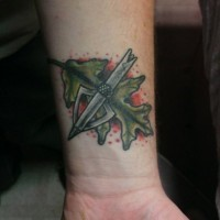 3D style colored old school modern arrow head tattoo on wrist with leaf