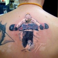 3D style colored upper back tattoo of man with large snowboard