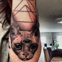 3D style creepy looking arm tattoo of evil cat with three eyes
