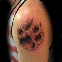 3D style detailed shoulder tattoo of animal paw print