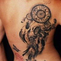 3D style very detailed back tattoo of dream catcher and feather