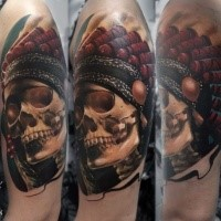 3D style very detailed shoulder tattoo of Indian skull with feather helmet