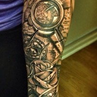 3D very detailed black and white nautical themed tattoo with compass and flowers tattoo on arm