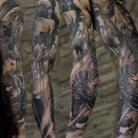 Abstract full sleeve tattoo with mechanical elements