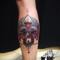 Abstract metal skull tattoo on leg