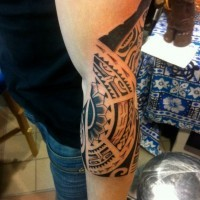 Amazing tribal black-ink pattern tattoo for men on forearm