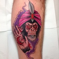 Amuse old school chimpanzee-soothsayer in pink turban tattoo on shin