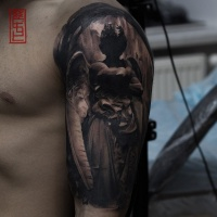 Angel statue tattoo on shoulder