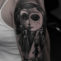 Awesome Coraline movie tattoo on shoulder