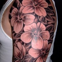 Awesome black-ink flowers tattoo for men on upper arm