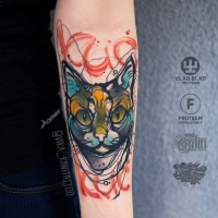 Awesome bright cat tattoo on wrist