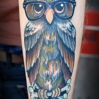 Awesome colorful owl in glassess tattoo for guys on forearm