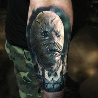 Awesome painted colorful tattoo of man in creepy mask