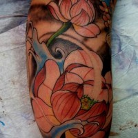 Awesome pale pink japanese lotus flowers in waves tattoo on upper arm