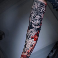 Awesome realistic tiger and flowers tattoo on arm