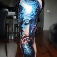 Awesome woman and space tattoo on leg
