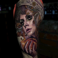 Awesome woman face tattoo on shoulder